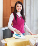Housewife ironing with iron Royalty Free Stock Photography