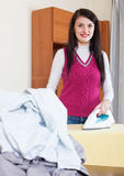 Housewife ironing with iron at home Royalty Free Stock Photo