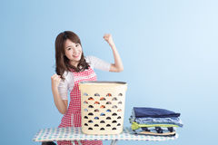Housewife with ironing and shirt Stock Photos