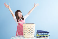 Housewife with ironing and shirt Stock Photo