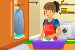 Housewife ironing. A vector illustration of a housewife ironing clothes at home Stock Photo