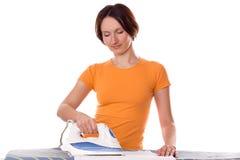 Housewife irons clothes Stock Photos