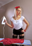 Housewife irons her blouse Royalty Free Stock Image