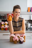 Housewife among jars with homemade fruits jam Royalty Free Stock Images