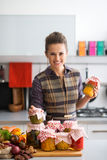 Housewife with jars of pickled vegetables Stock Photo