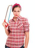 Housewife in kerchief with handsaw Royalty Free Stock Photography