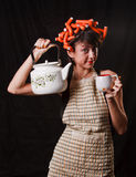 Housewife with a kettle and a cup Stock Image
