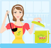 Housewife in kitchen Stock Photos