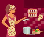 Housewife in the kitchen. Beautiful housewife in the kitchen Royalty Free Stock Photos