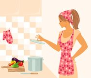 Housewife in the kitchen. Beautiful housewife in the kitchen Royalty Free Stock Photo