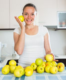 Housewife in the kitchen with apples Royalty Free Stock Image