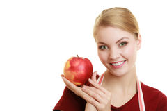 Housewife in kitchen apron offering apple healthy fruit Stock Photo
