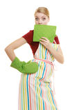 Housewife in kitchen apron surprised face wide eyes Stock Image