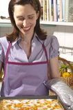 Housewife in the kitchen, baking cakes Royalty Free Stock Photography