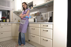 Housewife in the kitchen, cleaning Stock Images