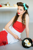 Housewife in the kitchen Royalty Free Stock Photography