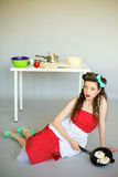 Housewife in the kitchen Stock Images