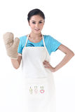 A housewife with kitchen protective glove Stock Image