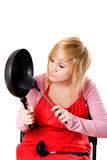 Housewife with kitchen utensil Stock Image