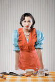 Housewife in the kitchen. Vintage portrait of a housewife in the kitchen Royalty Free Stock Photos