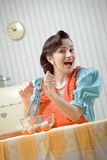 Housewife in the kitchen. Vintage portrait of a housewife in the kitchen Stock Photo