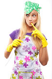 Housewife and knife. Young beautiful housewife in rubber yellow gloves with knife Royalty Free Stock Photos