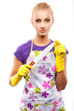 Housewife and knife. Young beautiful housewife in rubber yellow gloves with knife stock photography