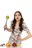 Housewife with a knife Royalty Free Stock Photo