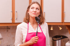 Housewife with ladle in kitchen Royalty Free Stock Photo