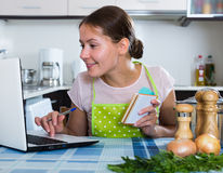 Housewife with  laptop at home Stock Image