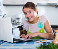 Housewife with laptop at home Stock Images