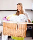 Housewife with large linen basket Stock Images