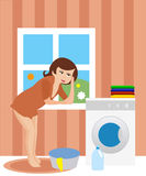 Housewife in the laundry Royalty Free Stock Images