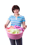 Housewife with laundry basket. Stock Photo
