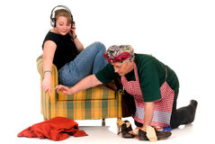 Housewife with lazy daughter. Middle aged stressed housewife with lazy teenager daughter Stock Photography
