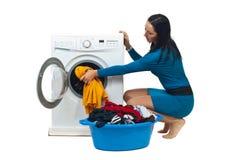 Housewife loading washing machine stock image