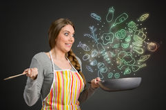 Housewife looking at drawing  vegetables Royalty Free Stock Photography