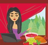 Housewife looking in laptop during cooking soup at home kitchen Royalty Free Stock Photos
