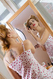 Housewife looking at the mirror Royalty Free Stock Images