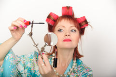 Housewife with a magniglass Stock Photo