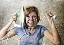 Housewife or maid domestic service woman holding upset an iron strangling her neck Royalty Free Stock Photos