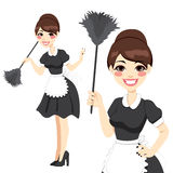 Housewife Maid Duster. Beautiful housewife in classic maid dress costume holding a feather duster isolated on white background Royalty Free Stock Photo