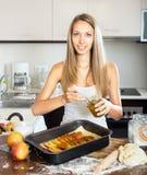 Housewife making cake Stock Photos