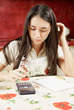 Housewife making calculations Royalty Free Stock Image