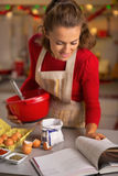 Housewife making christmas cookies in kitchen Stock Photos