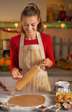 Housewife making cookie  in kitchen Royalty Free Stock Image