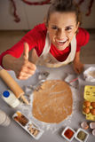 Housewife making cookies showing thumbs up Royalty Free Stock Photography