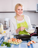 Housewife making dough Royalty Free Stock Image