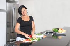 Housewife making fresh salad Royalty Free Stock Photos