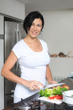 Housewife making fresh salad Royalty Free Stock Images